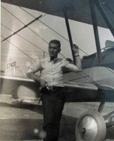 Grandpa with open cockpit plane in 1920's