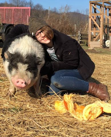 Selick the Pig with Rachael the Volunteer